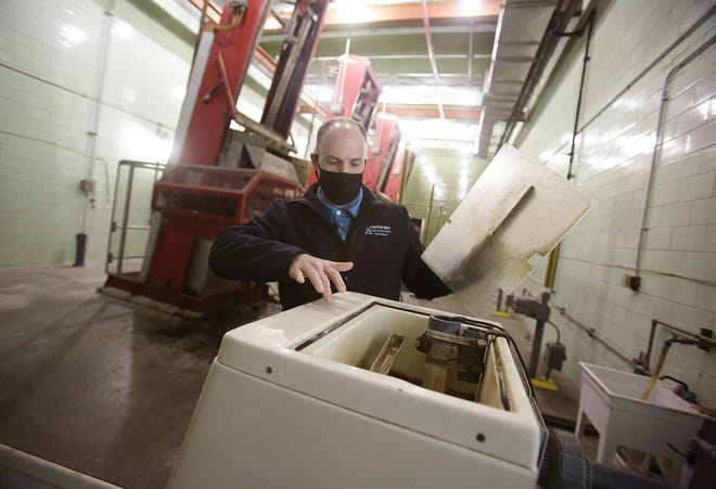 Marc Morgan, superintendent of the Canton Water Reclamation Facility, shows where composite samples are collected from a raw sampler every Monday and Wednesday to be sent to Kent State University's lab.