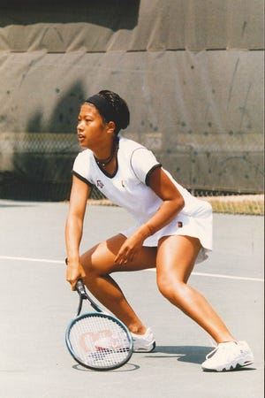 Former Belvidere star Eva Marcial, shown playing in college, started three years for Texas A&M, playing both singles and doubles.