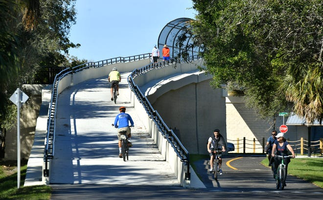 An overpass on the Legacy Trail keeps cyclists and pedestrians from having to negotiate traffic on Laurel Road. The paved extension of the trail south into North Port is expected to be complete by fall of next year.