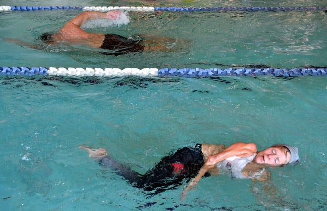 Kathi Coleman swims laps for an hour every morning at LA Fitness in Sarasota. Coleman, 72, has a paralyzed left leg and right arm as a result of contracting polio in her infancy.