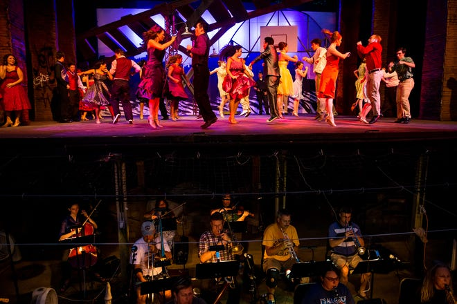 """The feuding gangs, the Jets and the Sharks, perform a dance routine as the orchestra performs in the pit during rehearsals for """"West Side Story"""" at The Muni in 2015. The Muni has announced that the 2021 season has been canceled because of the COVID-19 pandemic, making it two seasons in a row The Muni has been dark. [Justin L. Fowler/The State Journal-Register]"""