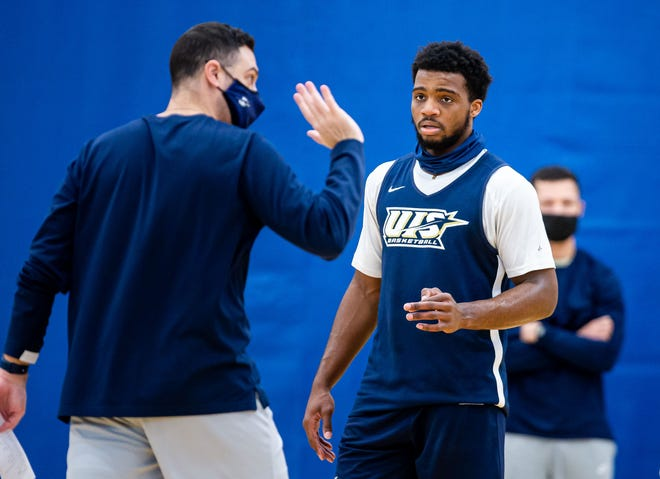 University of Illinois Springfield sophomore Chase Robinson, center, listens to instructions from assistant coach Pat Sodemann, left, during practice at the Recreation & Athletic Center in Springfield, Wednesday, January 27, 2021. [Justin L. Fowler/The State Journal-Register]
