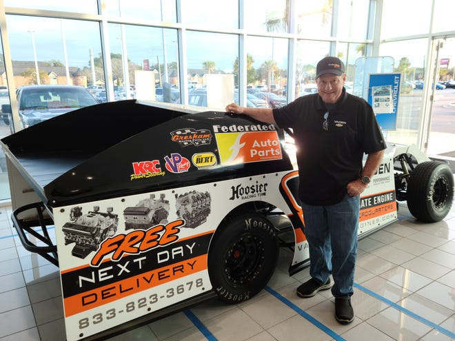 Professional racer Ken Schrader poses next to his No. race 9 car at Vaden Chevrolet in Savannah on Wednesday evening.