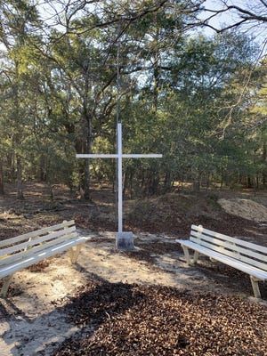 Federal Point Methodist's cemetery remains active, and a large cross at the back of the graveyard memorializes the location of the old church.