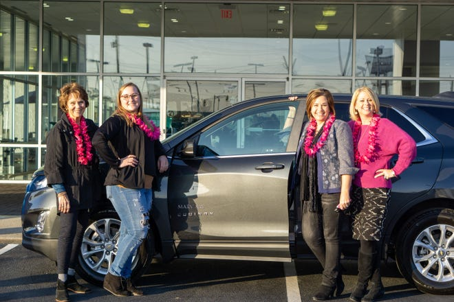 Mary Kay Independent Sales Director Mary Ann LeRay of Pollocksville, pictured third from left, has earned the use of a new Chevy Equinox crossover as a result of her outstanding achievements in her Mary Kay business. [CONTRIBUTED PHOTO]