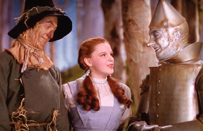 """The Scarecrow (Ray Bolger) and Dorothy (Judy Garland) speak with the Tin Man (Jack Haley) during a scene from the 1939 film """"The Wizard of Oz,"""" which has become permanently associated with Kansas."""