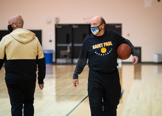 St. Paul girls' basketball coach Barry Finneron looks on during a recent practice.