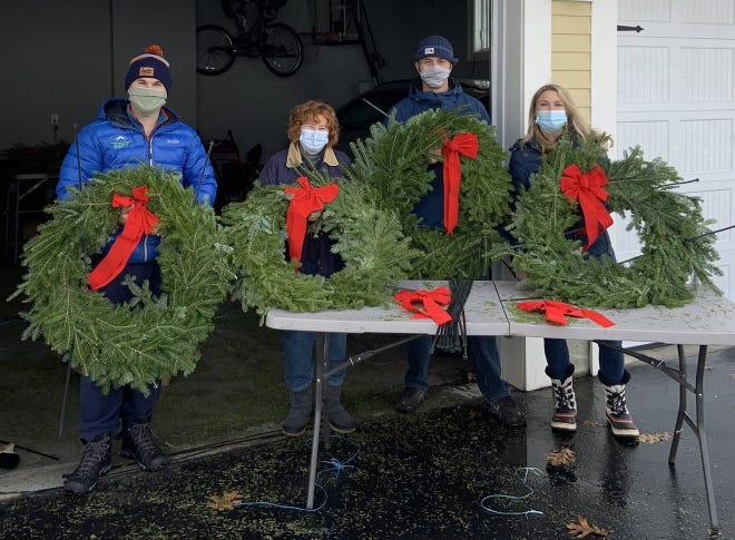Bolton Economic Development Committee volunteers get wreaths ready before the holiday season.