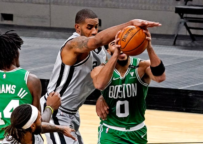 Celtics forward Jayson Tatum (0) is thwarted on a drive to the basket by Spurs center LaMarcus Aldridge during the second quarter Wednesday night in San Antonio.