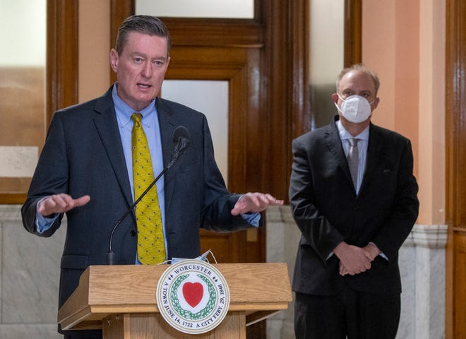 City Manager Edward M. Augustus Jr., left, and Mayor Joseph M. Petty, right, speak during the city's Covid-19 press conference at Worcester City Hall Thursday.