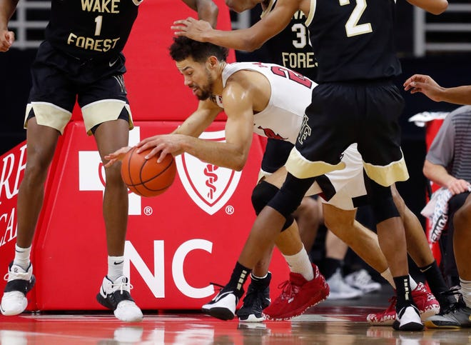 NC State's Devon Daniels (24), who posted a double-double with 20 points and 10 rebounds in the Wolfpack's win against Wake Forest on Wednesday, exited the game with a leg injury late in the second half.