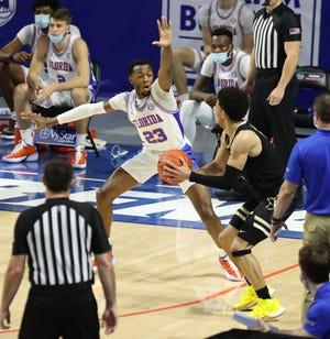 Florida sophomore guard Scottie Lewis defends Vanderbilt guard Scotty Pippen Jr. (2) during Wednesday's game at Exactech Arena.