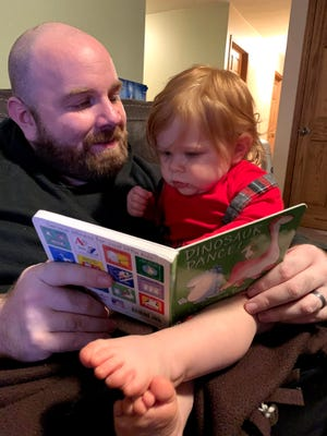 Andrew and Eliza Wilsterman read a book provided by United Way of Tuscarawas County.
