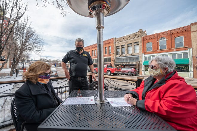 Mike Pacheco, owner of Papa Jose's Union Cafe, speaks with patrons Vicky Winterscheidt, left, and Mona Klein on Thursday January 28, 2021.
