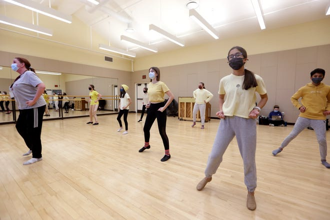 """Melissa Gould (left), director of the New Albany Middle School theater program leads (from left) eighth-grader Shelby Bilberry, seventh-grader Maggie Hill, seventh-grader Amelia Brechter, eighth-grader Samantha Downing, seventh-grader Annie Trybus, seventh-grader Maria Thiel and seventh-grader Sahil Shah during a rehearsal for """"Schoolhouse Rock Live! Jr."""" on Jan. 25 at the Jeanne B. McCoy Community Center for the Arts in New Albany. The musical will be performed by three separate casts of New Albany sixth-, seventh- and eighth-graders April 21-26 at the McCoy Center. Performances, six of which have been scheduled for April 22-25, according to the theater program's website, will be both live and livestreamed based on seating constraints because of the COVID-19 coronavirus pandemic."""