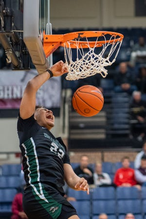 Waxahachie's CJ Noland slams home a dunk during an area-round playoff game against Coppell last March. Noland scored 31 points on Tuesday night as the No. 1-ranked Runnin' Indians won at Mansfield Lake Ridge, 66-43.