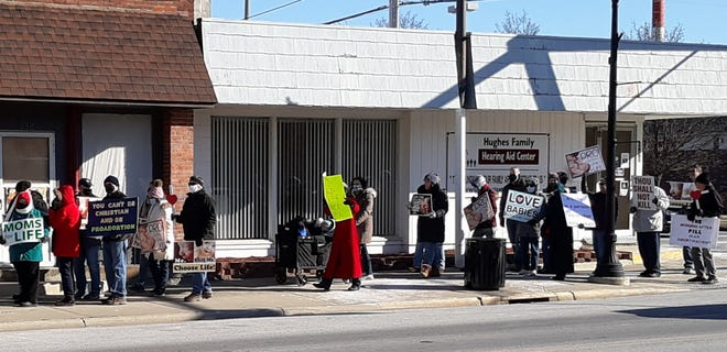Many participants in the Pro Life Walk carried signs as the marched along streets in downtown Bucyrus.