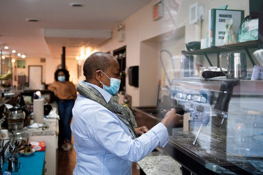 Owner Rosemari Hicks makes a shot of espresso at Nuanced Cafe in Camden.