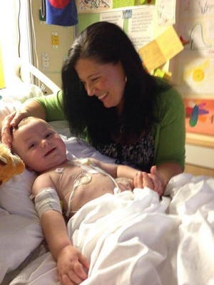 Tanya Gill smiles at Christian in their room at Children's.