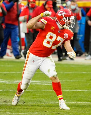 Jan 17, 2021; Kansas City Chiefs tight end Travis Kelce (87) celebrates against the Cleveland Browns in an AFC Divisional Round playoff game at Arrowhead Stadium.
