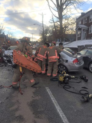 Four people were injured, one seriously, in a crash on Gilbert Avenue.