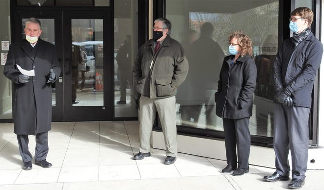 Dr. Scott Wegner introduces doctors David and Brenda Lozowski and Brandon Hill, who will the initial physicians at the new Genesis Coshocton Family Practice at 410 Main St. A ribbon cutting was held Thursday and patients will be seen starting Monday.