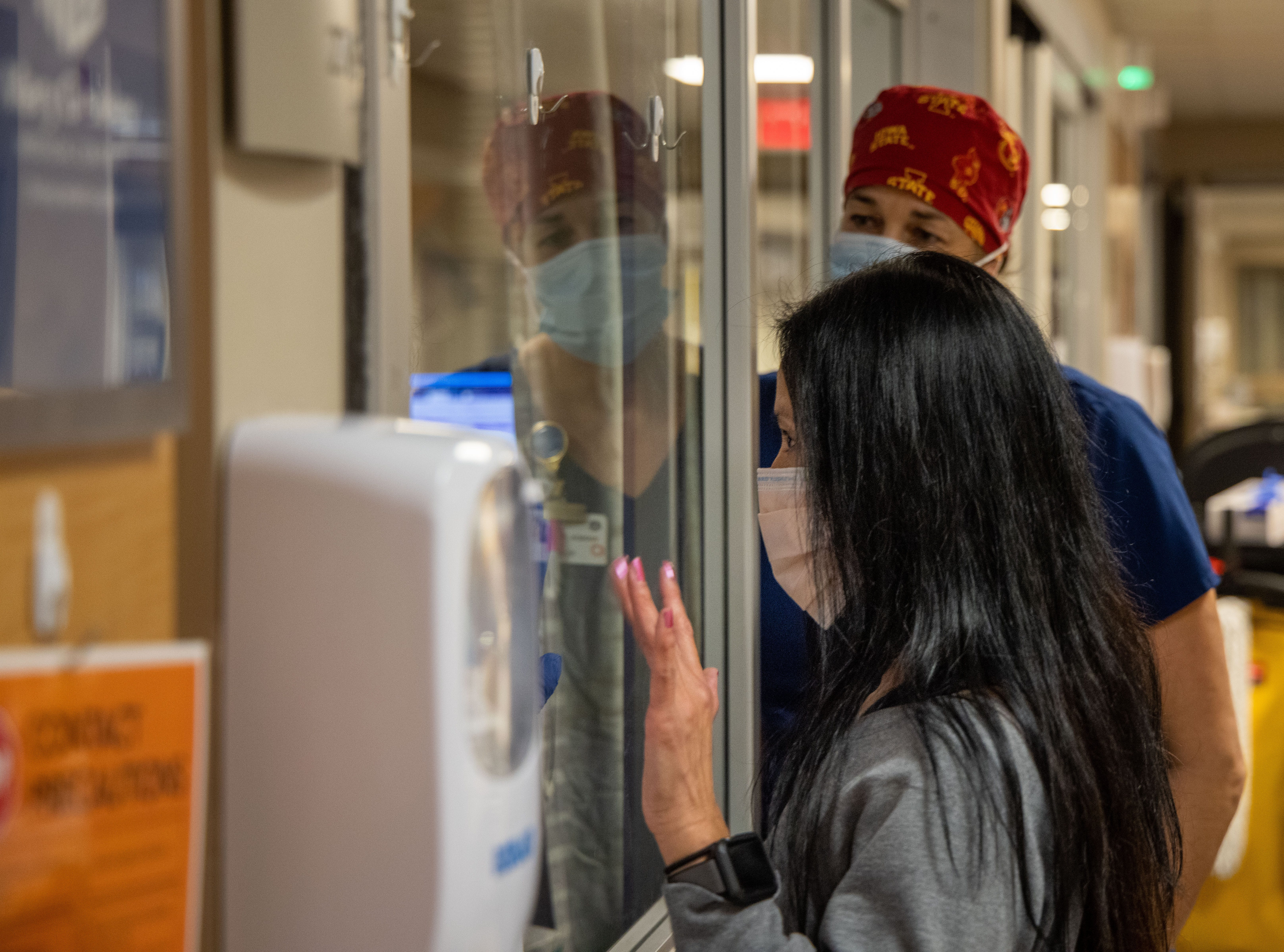 Jade Robinson waves to her mother Thong Sengphirom as she arrives for a visit in the ICU at Mary Greeley Medical Center in Ames, Iowa, Friday, Dec. 11, 2020.