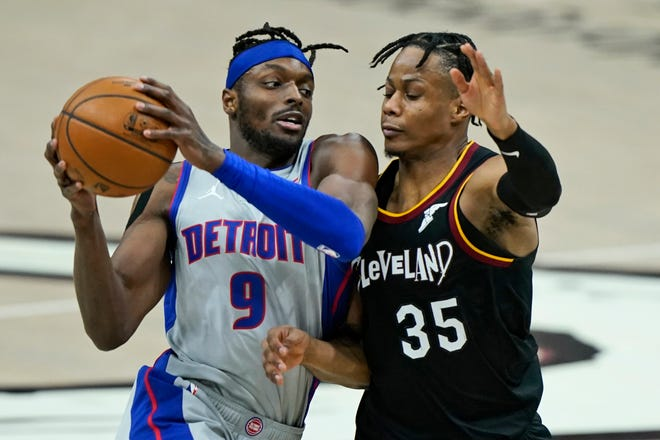 Cavaliers forward Isaac Okoro guards the Detroit Pistons' Jerami Grant (9) during a game earlier this season. Okoro, who usually guards the opposing team's best player, believes he should have been the first player chosen in the NBA Draft. [USA TODAY Network]