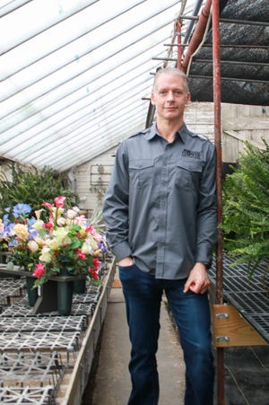 Nathan Noblit, a 1997 Harding High School graduate, is president and owner of Marion Flower Shop.