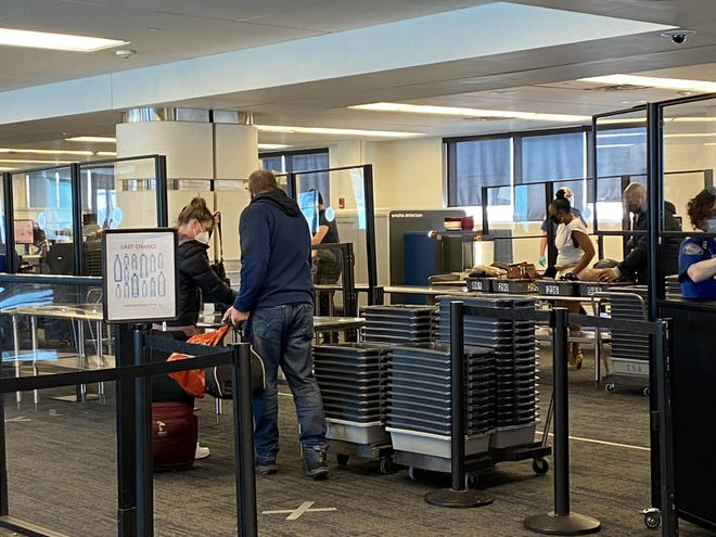 Passengers move through the security screening area at Milwaukee Mitchell International Airport. The U.S. Transportation Security Administration is operating new, more technologically advanced screening equipment at the airport.