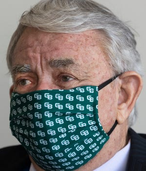 Sporting a cloth mask from UW-Green Bay, Tommy Thompson is shown at work Jan. 27, 2021, at UW-Madison.