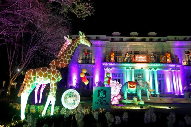 """A circus-themed display, one of the many elaborate presentations among the stately homes on St. Charles Avenue in Uptown as New Orleanians create """"house floats"""" to celebrate the Carnival season after the pandemic cancelled the traditional parades. (Photo by Michael DeMocker)"""