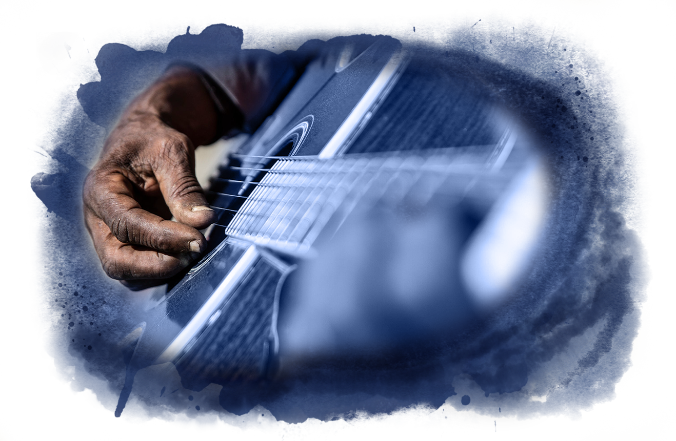 """Jimmy """"Duck"""" Holmes plays his guitar in front of the Blue Front Café in Bentonia, Miss."""