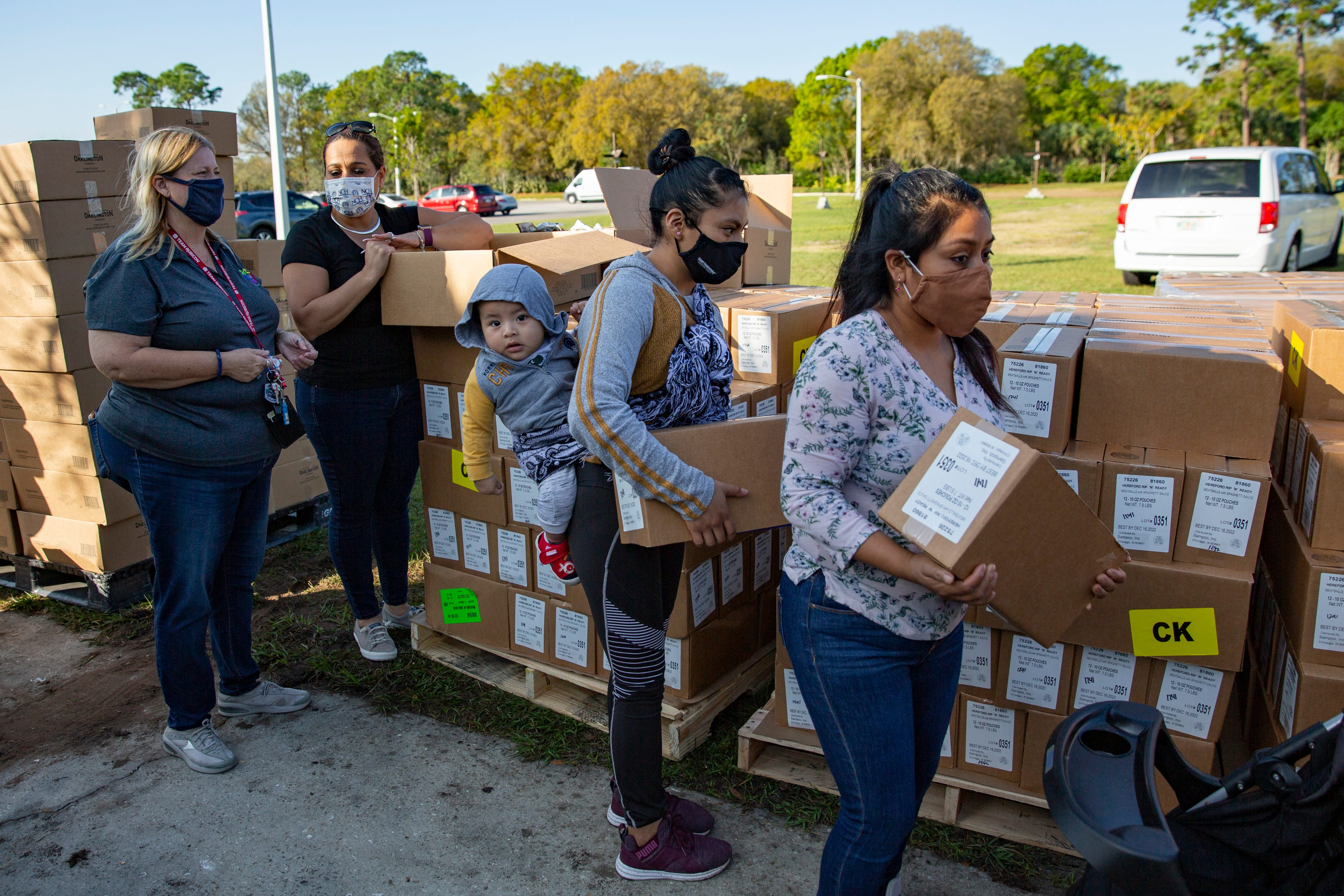 Community members collect boxes containing food during a homeless count in January hosted by the Collier County Hunger and Homeless Coalition at Guadalupe Social Services in Immokalee.