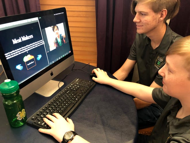 City Slicker 4-H Club members Keyon Kamali, on monitor screen, Alex Chamberlin, center, and Carter Chamberlin work on the presentation of their action plan after designing a solution to food insecurity in their community. They were among 11 4-H members from around the state that participated in the 24-hour virtual Hackathon 2020.