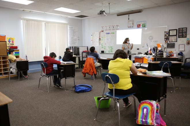 Hybrid learning takes place at Park Avenue Elementary in Aztec Municipal School District on Sept. 23, 2020. Teachers split their attention by teachers students in-person and online simultaneously.