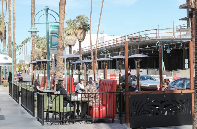 People dine outdoors at Tac/Quila in downtown Palm Springs, January 28, 2021.