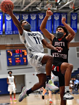 Dallastown's Michael Dickson, left, takes the ball to the basket while South Western's Shilo Bivins defends during boys' basketball action at Dallastown Area High School in York Township, Wednesday, Jan. 27, 2021. Dallastown would win the game 51-43. Dawn J. Sagert photo
