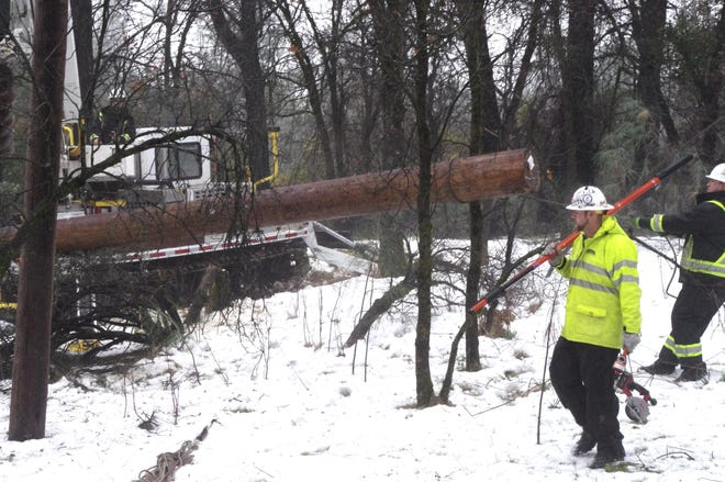 Crews with the Wilson Construction Co. of Canby, Oregon worked off Union School Road near the city of Shasta Lake this week to repair Pacific Gas and Electrict Company utility poles that were damaged in the recent snow storm.