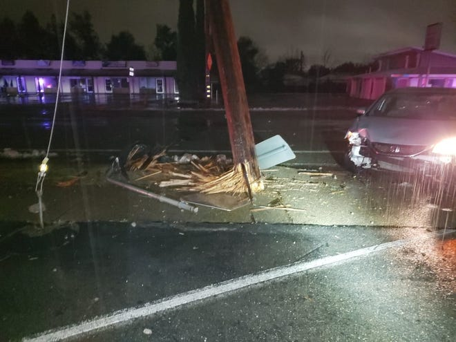 A car crashed into a power pole at the intersection of Bechelli Lane and Cypress Avenue on Thursday morning, forcing officials to close the intersection while crews repaired the pole.