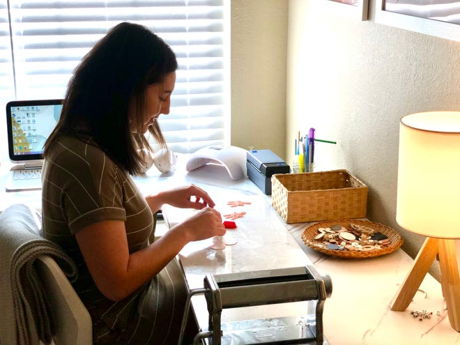Jasmine Coffman creates clay creation jewelry out of her home in San Angelo.