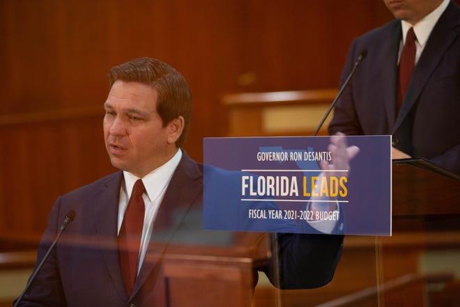 Gov. Ron DeSantis reveals his fiscal year 2021-2022 budget proposal in a press conference at the Capitol Thursday, Jan. 28, 2021.