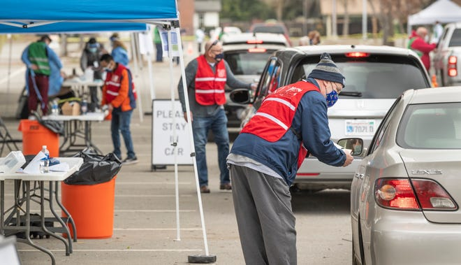 COVID-19 vaccine was given to hundreds during the drive-thru event at College of the Sequoias on Friday, January 22, 2021.