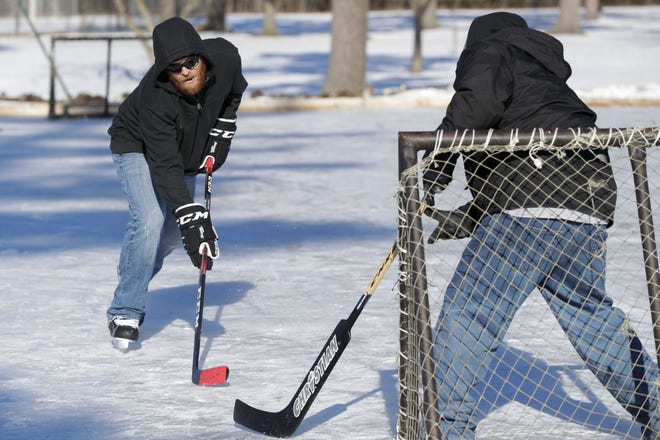 Sam Farley tries to score a goal against JP Striegel on Jan. 22 at Robinson Park in Wisconsin Rapids.