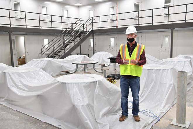Wichita County Precinct 1 Commissioner Mark Beauchamp answers questions from the media during a tour Thursday. The 188,000 square foot facility is about 88 percent completed.