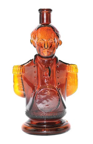 This circa 1876 Simon's Centennial Bitters bottle represents George Washington when he was commander in chief of the Continental Army, 100 years before. The red amber shaded to yellow amber bottle is 10 inches high and auctioned for $2,640.