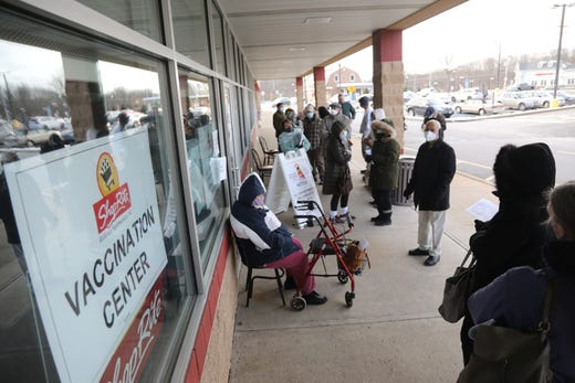 Those waiting to be vaccinated line up at an empty store next to Shoprite in Byram, N.J. Shoprite has taken appointments from members of the community and is administering  the vaccine.