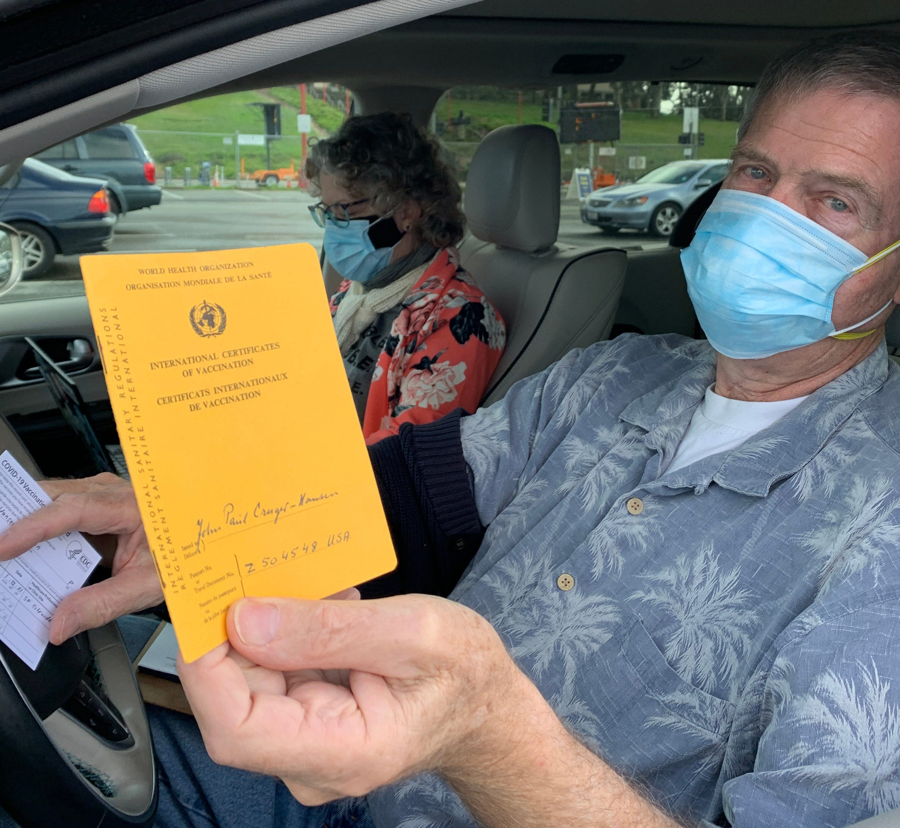 John Paul Cruger-Hansen, 77, brought the International Certificate of Vaccination he presented when he came to the USA decades ago from Denmark that proved he'd been vaccinated for smallpox. He hoped to get his COVID-19 vaccination noted in it at a mass vaccination clinic in San Francisco on Jan. 22.