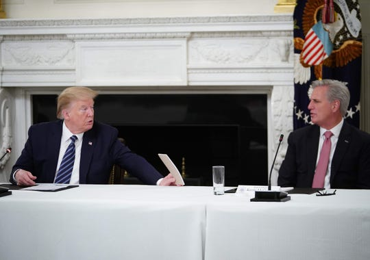 President Donald Trump and Rep. Kevin McCarthy, R-Calif., in a 2020 meeting.