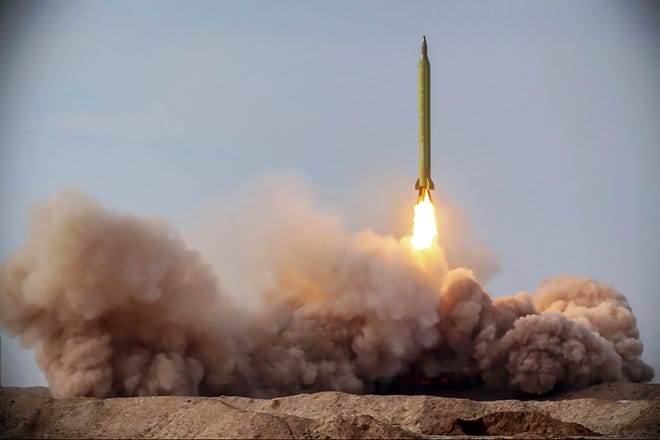 Iran's Revolutionary Guard launches a missile as part of a drill on Jan. 26, 2021.